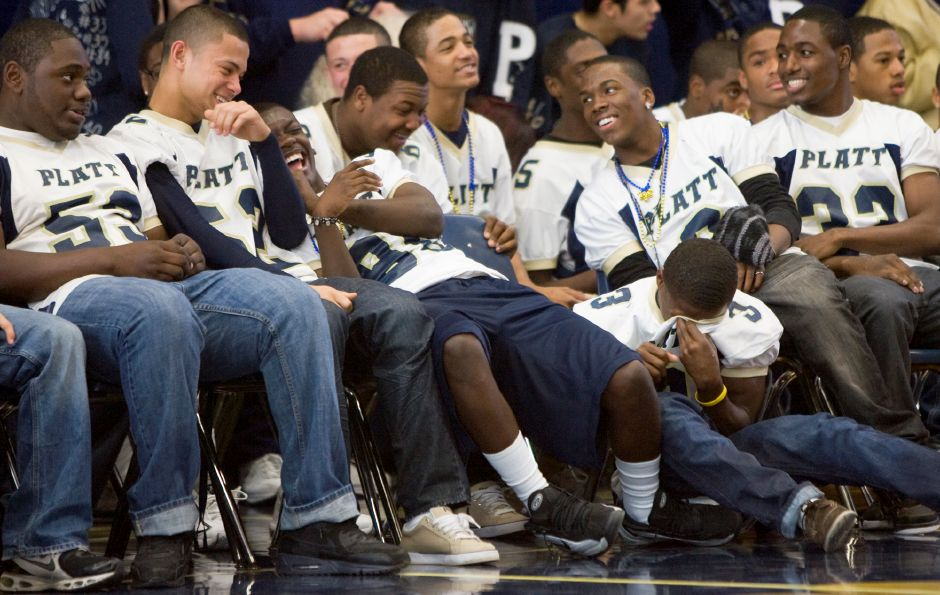 Platt Panthers football team react to the powder puff cheerleaders performing during the school