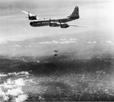 An American B-29 Super fortress of the U.S., 20th. Bomber Command, one of several participating in the attack, drops its bombs on the Showa steel works in Anshan, Manchuria  August 29, 1944, second largest iron and steel plant in the Jap system. (AP Photo)