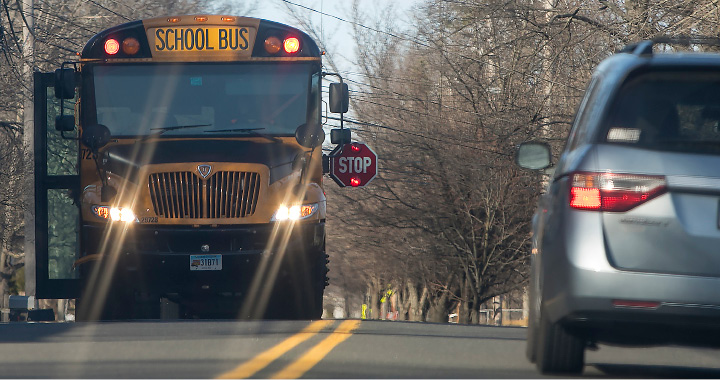 A school bus makes a stop along its route in Wallingford on Thursday.| Dave Zajac, Record-Journal