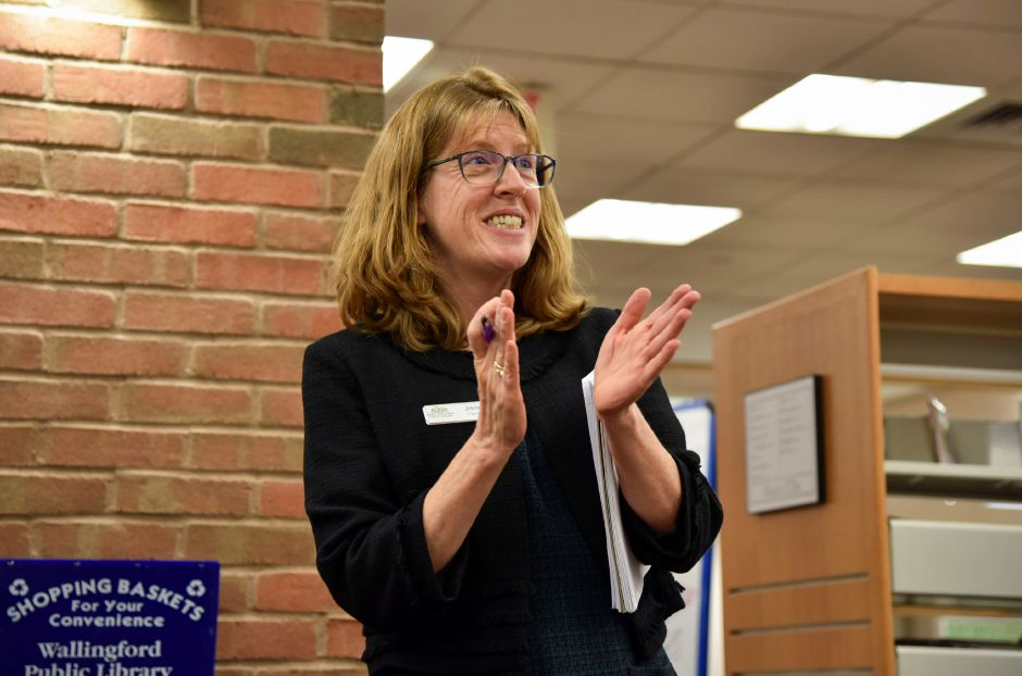 Wallingford Public Library Director Jane Fisher thanks the library staff and book-choosing committee members for their work before the One Book One Wallingford Book is revealed at the library on Wednesday, Jan. 10, 2018. | Bailey Wright, Record-Journal