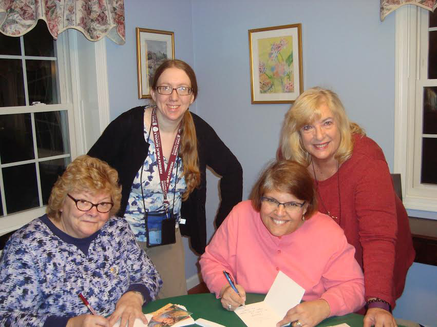 Irene Veillette, Anne Sharnick, Mary Lou Woods, and Mary Ann Blakely working on Psi chapter's altruistic project for November.