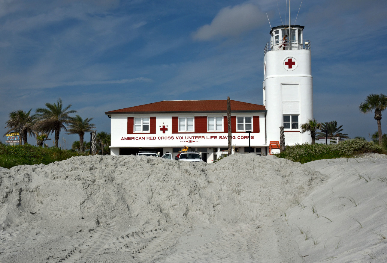 The American Red Cross Volunteer Life Saving Corps station sits behind a city installed sand berm across the beach access points to help slow the flow of any storm surge from Hurricane Irma, Thursday Sept. 7, 2017, in Jacksonville Beach, Fla. (Bob Mack/The Florida Times-Union via AP)