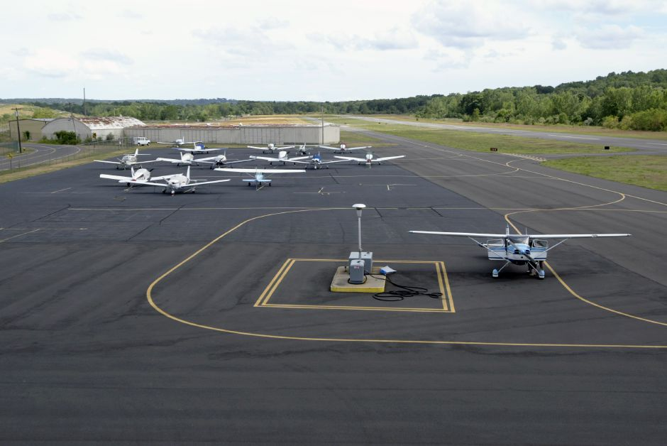 Meriden Markham Airport, under new ownership, is shown on Friday, July 9, 2010. There are plans to tear down the old hangar, background, and replace it with a newer one including a restaurant/lounge. (Rob Beecher / Record-Journal)