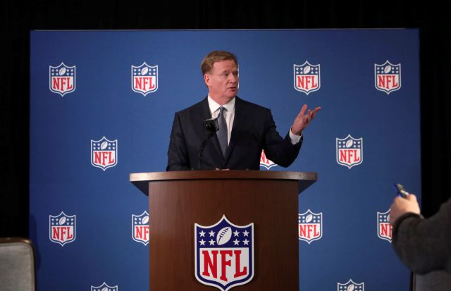 NFL commissioner Roger Goodell speaks to reporters during a news conference after the football leagues