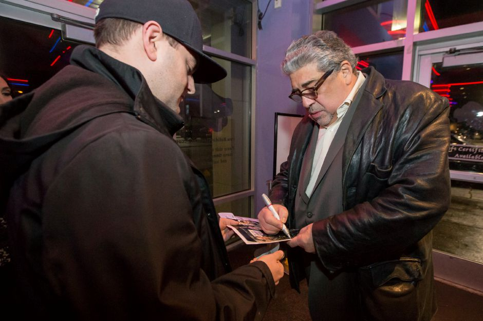 "Actor Vincent Pastore signs an autograph for Wallingford resident Keith Massimino Thursday during the premiere of ""Blood Circus"" at Holiday Cinemas in Wallingford. The movie was filmed in Connecticut at locations  including Meriden, Middletown and Portland."