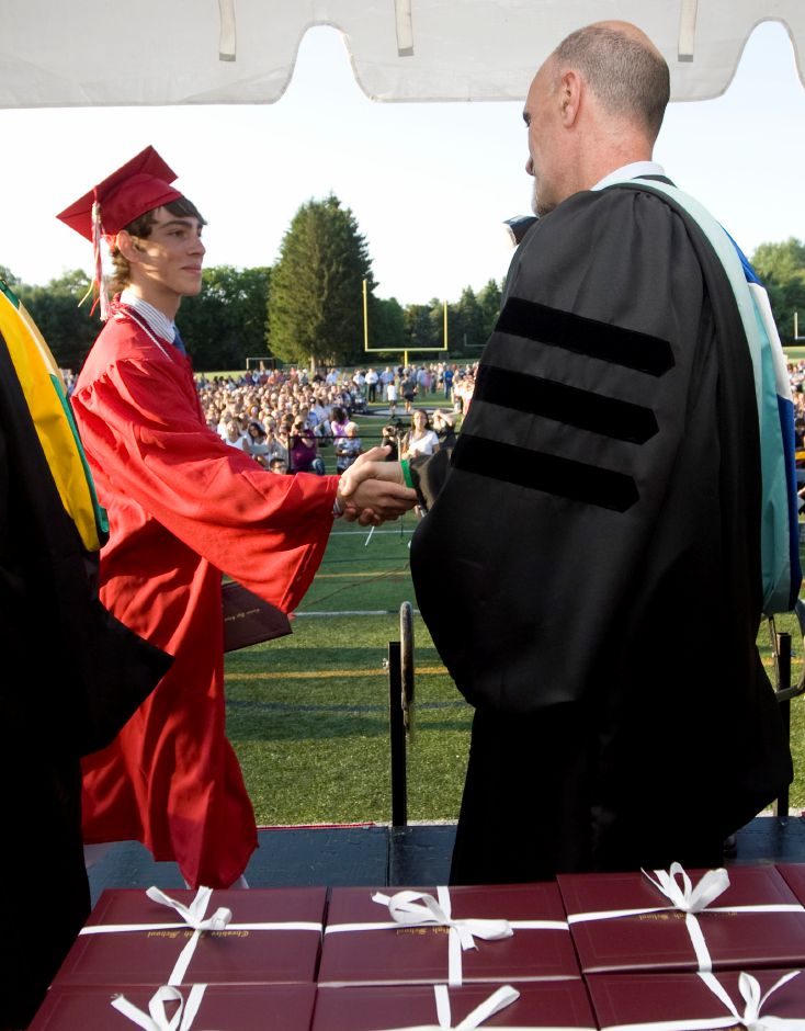 Graduate, Jonathan Cole, receives his diploma during commencement ceremonies at Cheshire High School, Tuesday, June 24, 2014. | Dave Zajac / Record-Journal