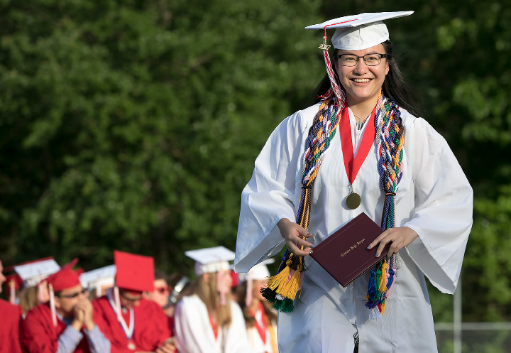 At left, graduate Lydia Feng is all smiles after receiving her diploma during graduation ceremonies at Cheshire High School.