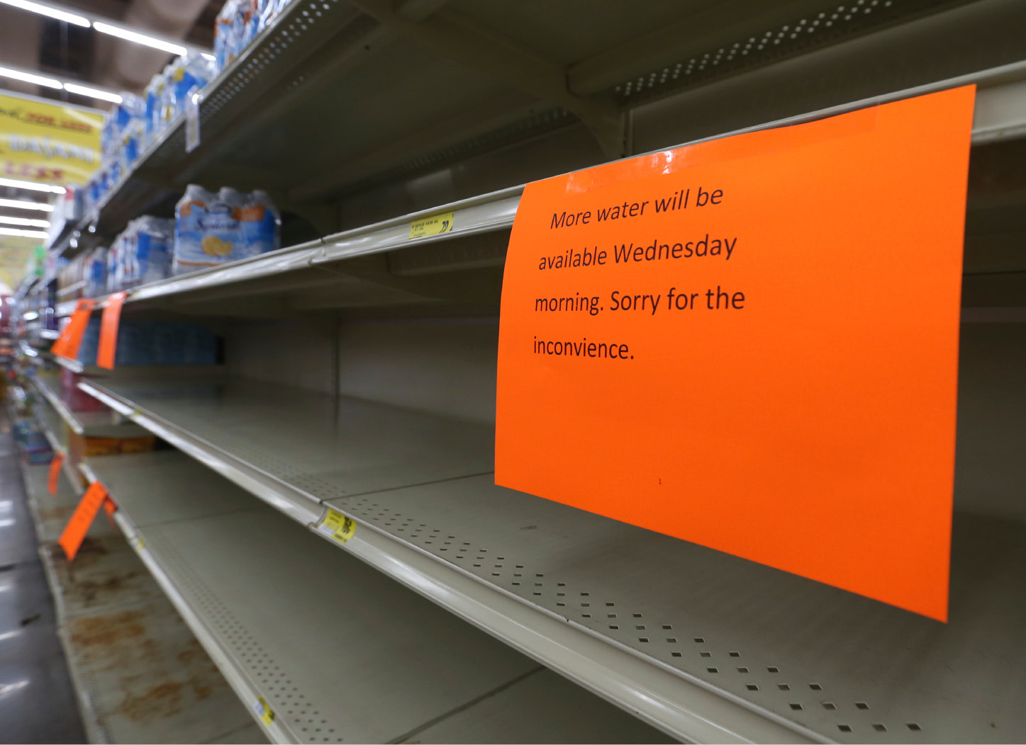 A shelf normally containing packaged water is empty at a Piggly Wiggly store Tueday, Sept. 5, 2017, in Panama City, Fla. Store managers informed shoppers that more water will be delivered on Sept.6 in the morning a residents prepare for Hurricane Irma. (patti Blake/News Herald via AP)