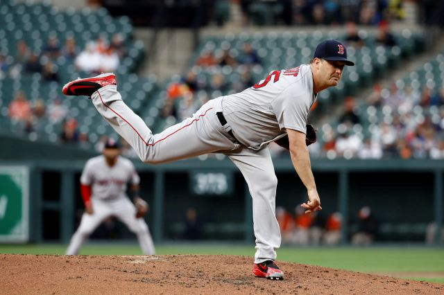 Boston Red Sox starting pitcher Steven Wright follows through on a pitch to the Baltimore Orioles in the third inning of a baseball game, Monday, June 11, 2018, in Baltimore. (AP Photo/Patrick Semansky)