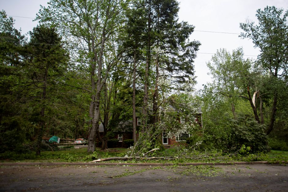 Residents clean up in Cheshire May 16, 2018 after a storm took down several trees in the area of Wintergreen Lane and Higgins Road. | Richie Rathsack, Record-Journal