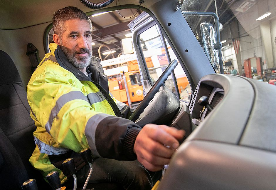 Mike Perrelli, maintainer 4, checks the controls of his truck as Wallingford Public Works crews prepare for the incoming storm, Fri., Jan. 18, 2019. State and local officials advise area residents to prepare for a mixture of snow and sleet predicted to fall throughout the weekend. Dave Zajac, Record-Journal