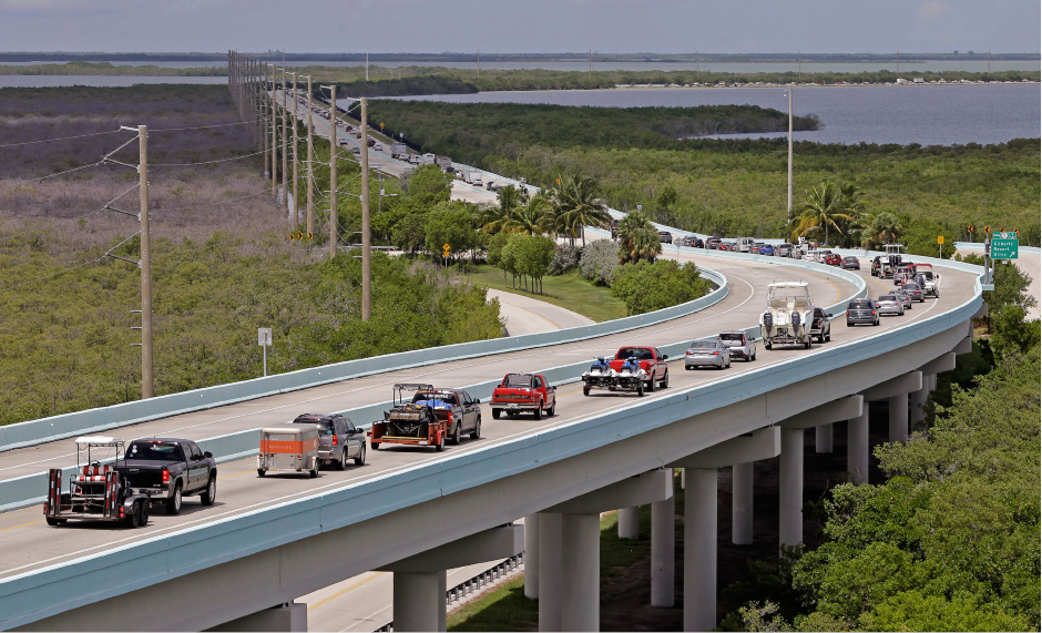 Motorists head north of Key Largo, Fla., on US 1, in anticipation of Hurricane Irma, Wednesday, Sept. 6, 2017.  Keys officials announced a mandatory evacuation Wednesday for visitors, with residents being told to leave the next day. (AP Photo/Alan Diaz)