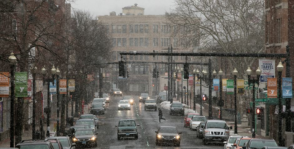 Motorists travel on West Main Street in downtown Meriden as the fourth nor