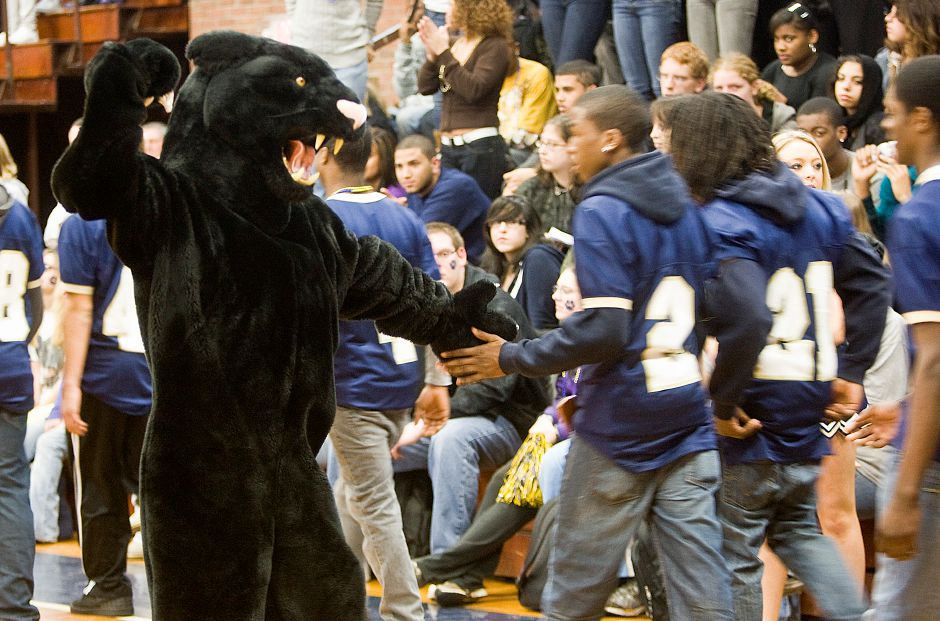 The Platt Panther high fives each of the Platt football players as they enter the gym for the pep rally on Wednesday, Nov. 25, 2009. Students and staff spent the last half hour of school together to rally support for their Thanksgviing Day football game against crosstown rival Maloney. (Christopher Zajac/Record-Journal)
