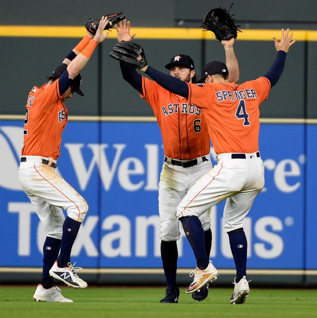 FILE - In this July 6, 2018, file photo, Houston Astros Josh Reddick, left, Jake Marisnick (6), and George Springer do a Fortnite celebration dance after the team