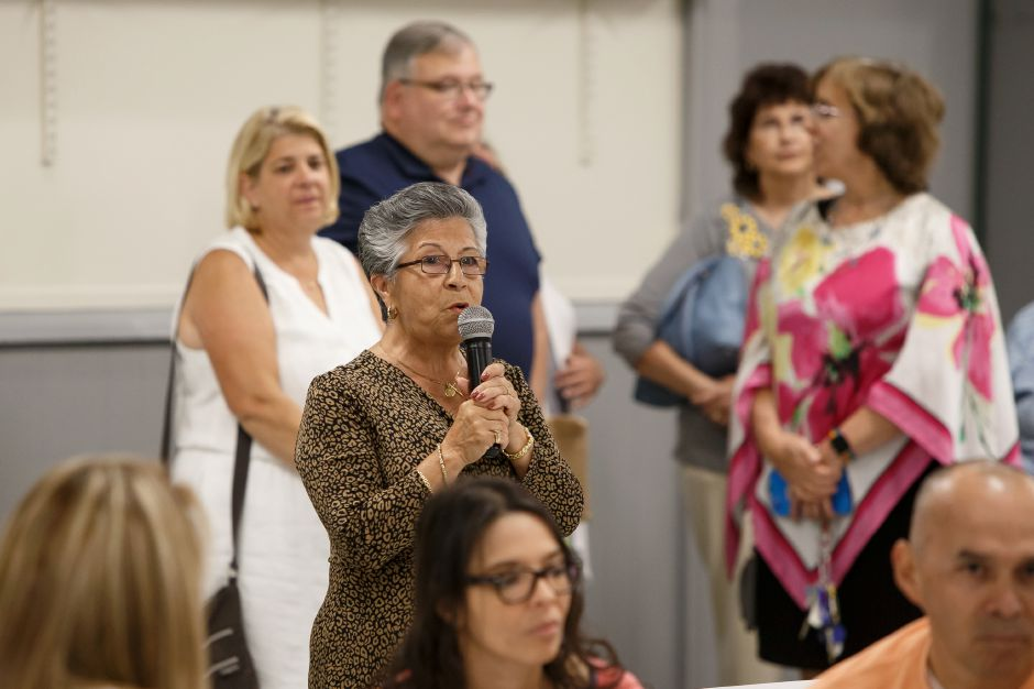 Marfth Trujillo welcomes guests Sunday during a farewell reception for Father Castro at Most holy Trinity Church in Wallingford August 19, 2018 | Justin Weekes / Special to the Record-Journal