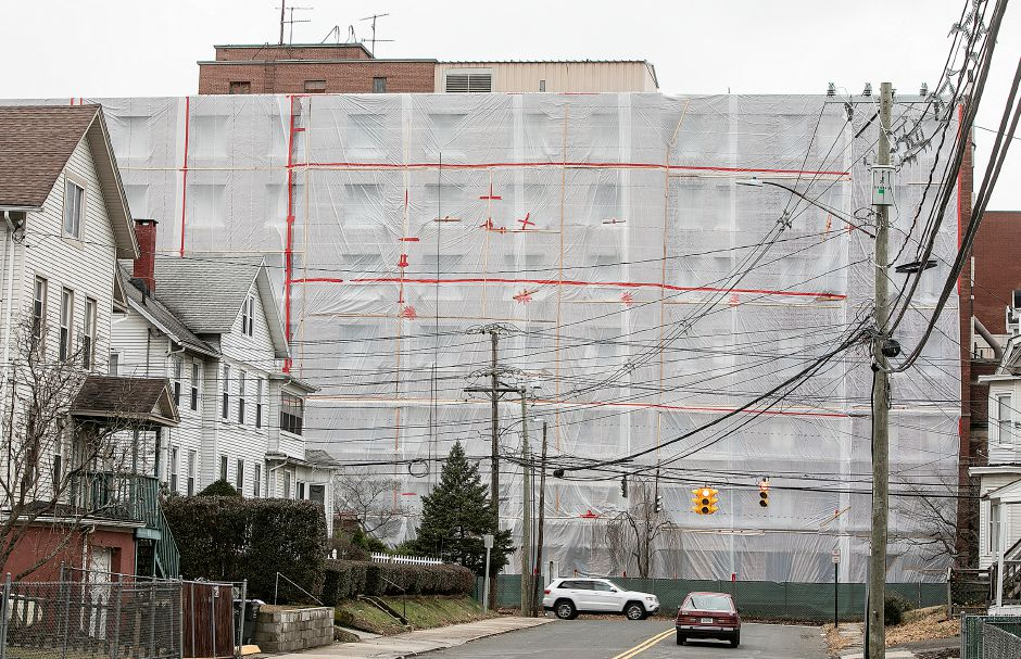 Protective plastic draped over the former Meriden-Wallingford Hospital on Cook Avenue as cleanup continues there, Mon. Nov. 26, 2018. Dave Zajac, Record-Journal