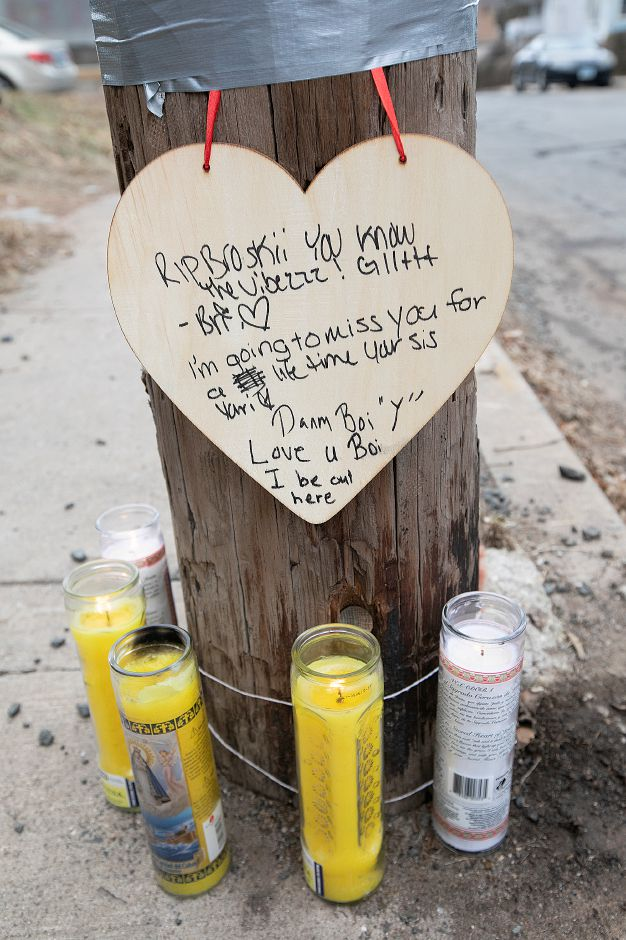 A memorial for Aaron Joseph Ormsby, 21, near 130 Foster St. in Meriden, Fri., Jan. 18, 2019. Ormsby was shot and killed in back of the residence Thursday night. Dave Zajac, Record-Journal