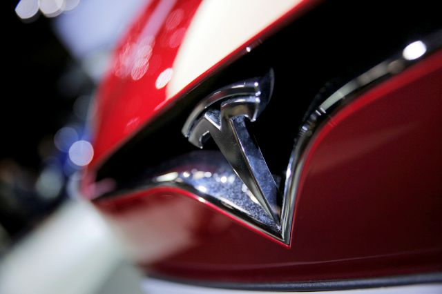FILE - This Friday, Sept. 30, 2016, file photo shows the logo of the Tesla Model S on display at the Paris Auto Show in Paris. Tesla Inc. reports earnings Wednesday, Nov. 1, 2017. (AP Photo/Christophe Ena, File)
