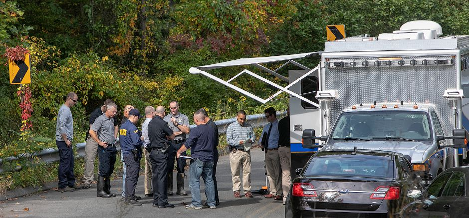 Local and state police investigate after a missing person was found dead near the intersection of Mixville and Marion roads in Cheshire, Thursday, Oct. 4, 2018. | Dave Zajac, Record-Journal