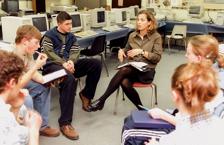 RJ file photo - Adviser Dianne Holst-Grubbe, center, talks to the staff of the Trojan Times during a recent meeting. At left are Jeremy DeLibero, the newspaper