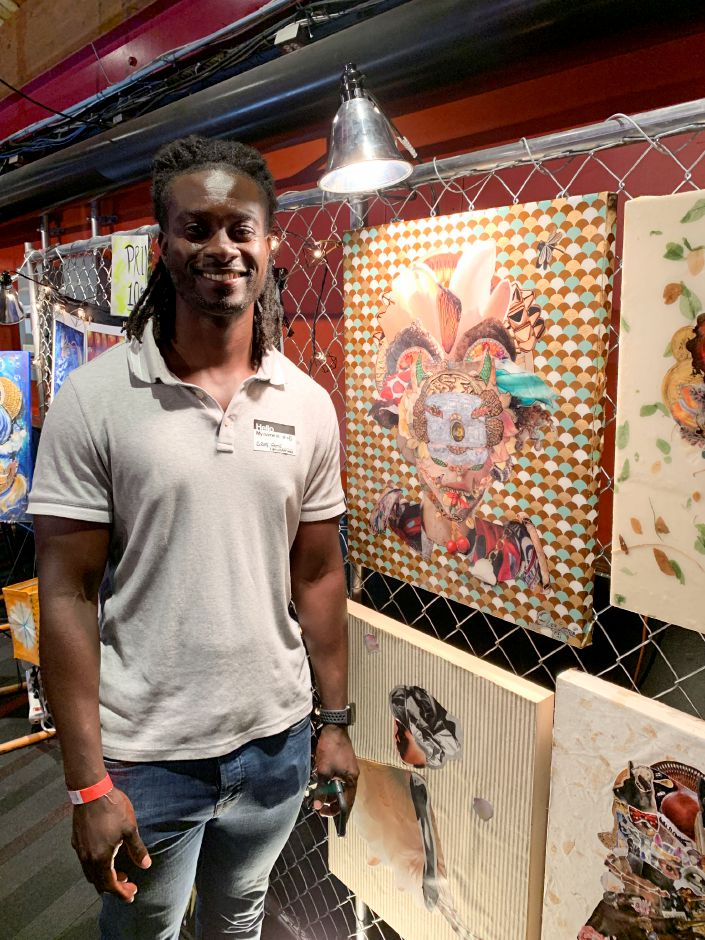 Greg Aime, of Bridgeport, with his art on display at a RAW Connecticut event on Wednesday. Around 40 artists, most from Connecticut, gathered at the Oakdale Theater in Wallingford Wednesday, August 21, 2019, for an annual RAW Artists event. The artists, which varied from painters to makeup artists and photographers, showcased their art in booths, and performers took the main stage. | Bailey Wright, Record-Journal