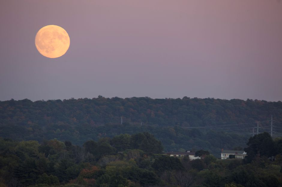 A full moon rises in the evening sky Oct. 4, 2017 as seen from the Record-Journal office in Meriden. | Richie Rathsack, Record-Journal