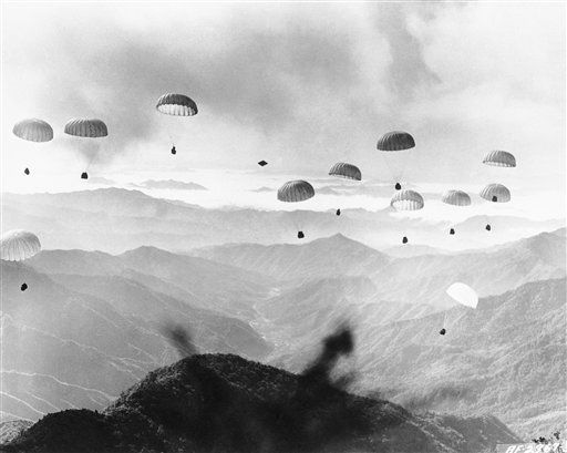 Five tons of supplies for an isolated U.S. Air Force radio station in Korea drift toward the target after being dropped by a C-119 Flying Boxcar of the 315th Air Division (Combat Cargo) on Oct. 25, 1952. Although low-hanging clouds and fog covered much of the area, all supplies including drums of gasoline and fresh water were dropped in an area where they could be recovered. None were damaged in landing on Rocky Mountains. (AP Photo)