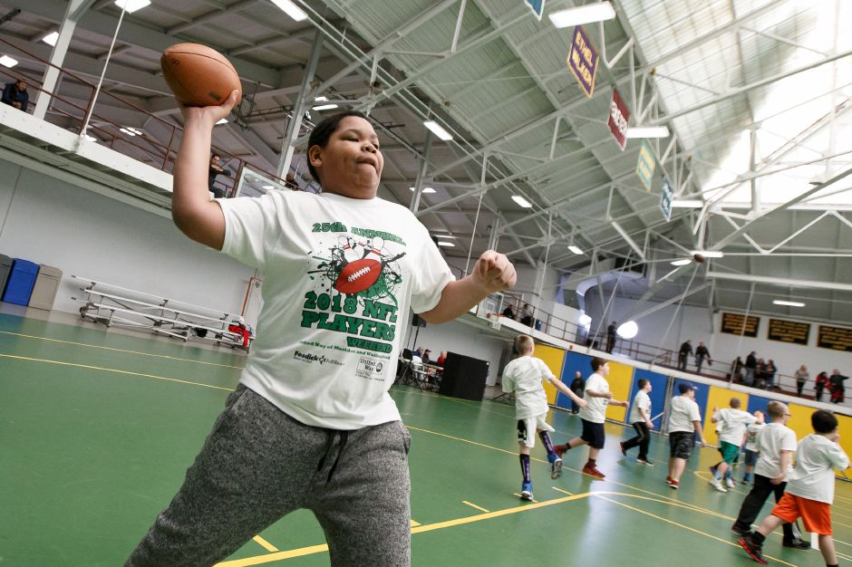 Nashawn Bates 11 of New Britain throws a pass to friends Saturday during the United Way NFL weekend kids camp at Choate Rosemary Hall in Wallingford March 10, 2018 | Justin Weekes / Special to the Record-Journal
