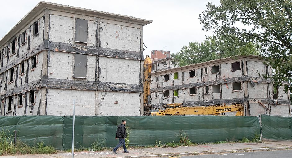 A man walks past the former Mills Memorial Apartments on Mill Street in Meriden as demolition continues, Monday, Sept. 24, 2018. Dave Zajac, Record-Journal