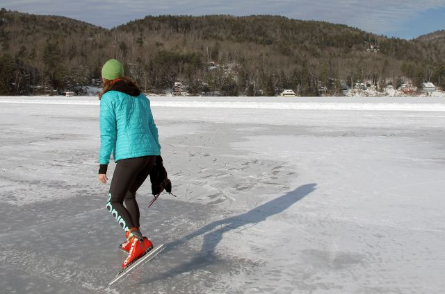 In this Jan. 20, 2018 photo, a skater wearing Nordic skates strides along on a 4.5-mile trail around Lake Morey in Fairlee, Vt., said to be the longest Nordic ice skating trail in the United States. (AP Photo/Lisa Rathke)