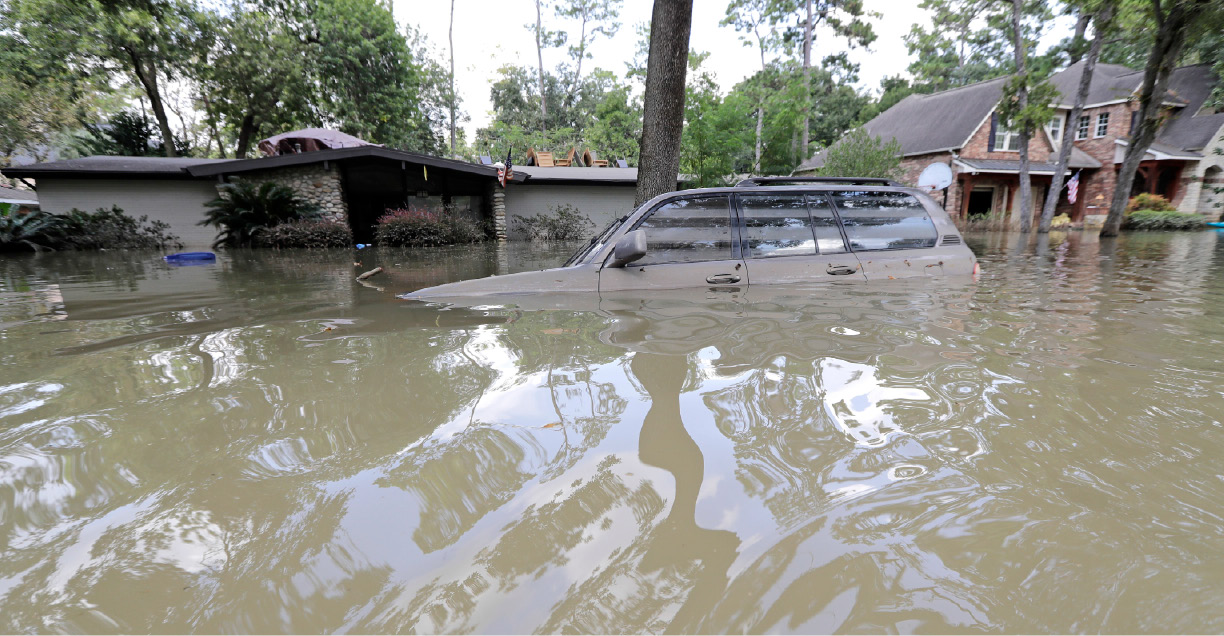 A car is submerged in floodwater in the aftermath of Hurricane Harvey, Monday, Sept. 4, 2017, near the Addicks and Barker Reservoirs in Houston. (AP Photo/David J. Phillip)