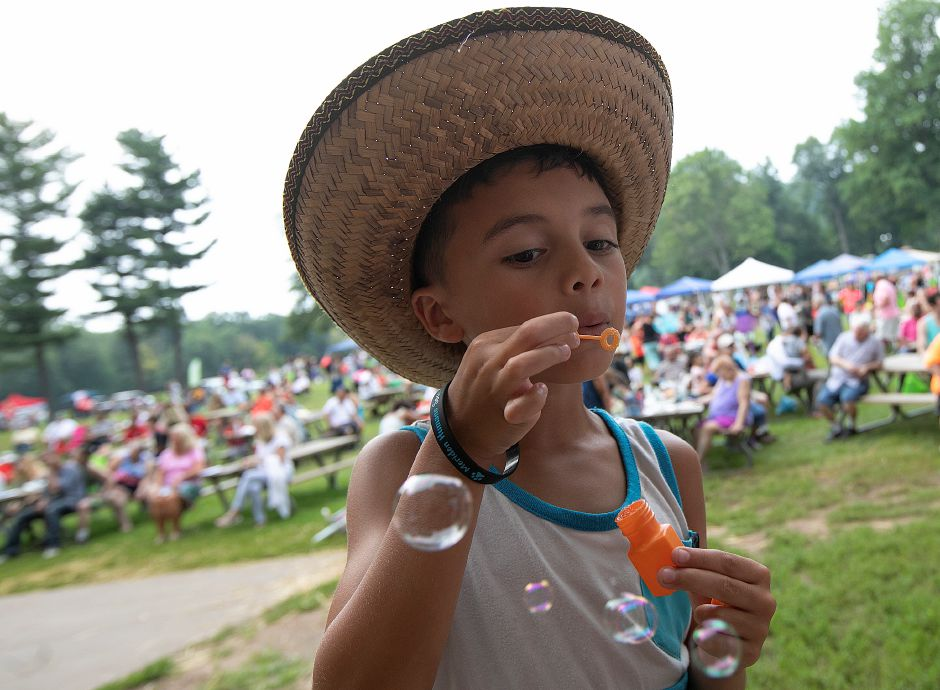 Aiden Rodriguez, 9, of Meriden, blows bubbles while attending the 14th annual National Night Out at Hubbard Park in Meriden, Tuesday, August 7, 2018. Dave Zajac, Record-Journal