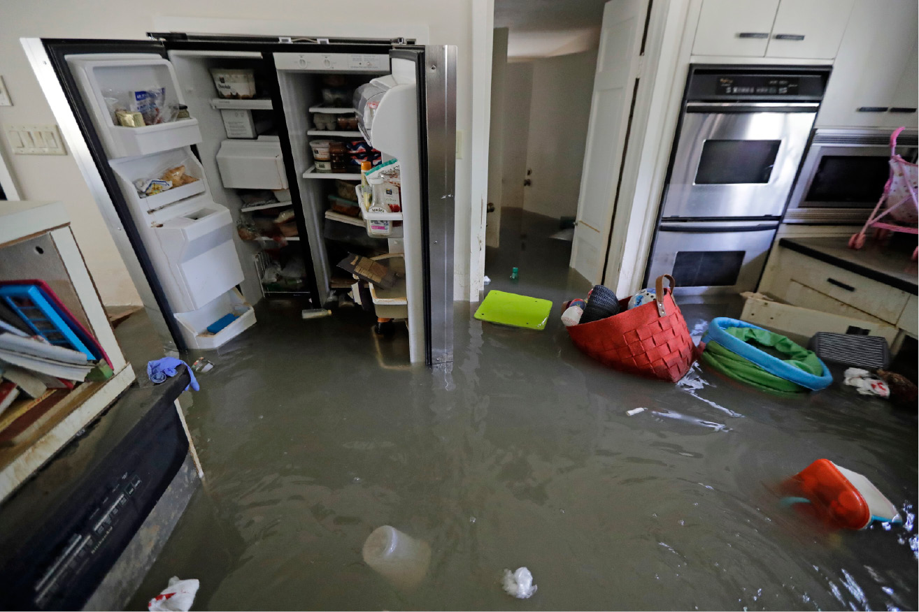The kitchen of the Kirby home is filled with floodwater in the aftermath of Hurricane Harvey, Monday, Sept. 4, 2017, near the Addicks and Barker Reservoirs, in Houston. (AP Photo/David J. Phillip)