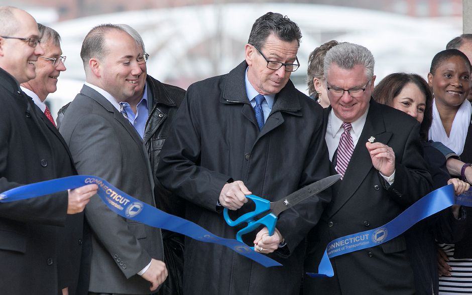 Gov. Dannel P. Malloy cuts the ceremonial ribbon at the Meriden train station, Thursday, April 19, 2018. State and city leaders crowded onto the platform at the new Meriden station to open the CTrail Hartford Line, which officials hope will provide an alternative option for commuters and potentially ease highway congestion. Dave Zajac, Record-Journal