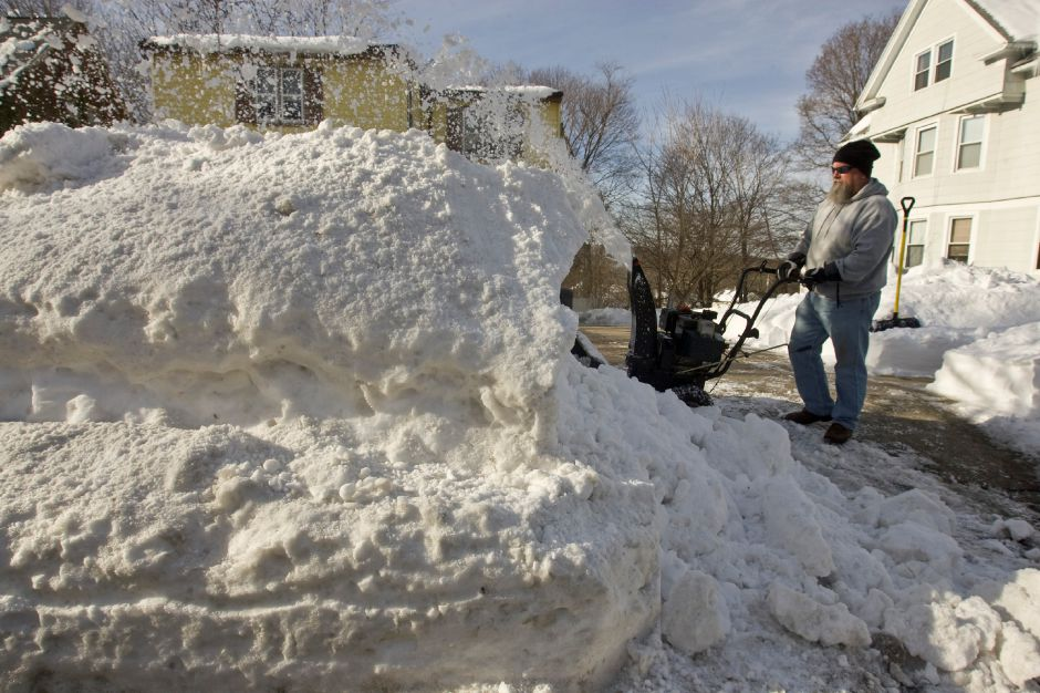 Henry Cadett [cq] uses a snow blower to widen the end of his mother-in-law