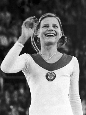 The gymnastics individual event at the summer Olympics in Munich gave the gold medal to 15 year old Olga Korbut, USSR, pictured here with her gold medal on Aug. 31, 1972. (AP Photo/Pool)