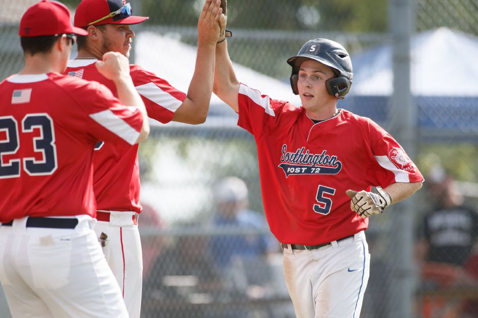 Dan Topper celebrates after scoring a run for Southington during Post 72's 4-0 victory over Cheshire in an American Legion South Division super regional game Sunday at Ceppa Field in Meriden. | Justin Weekes / Special to the Record-Journal