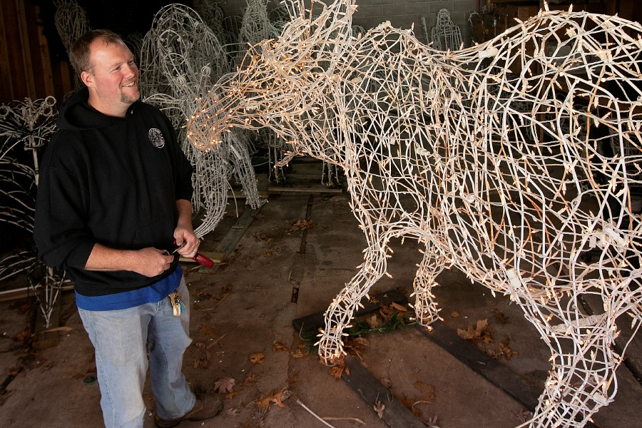 BJ Vernon, a worker for Meriden Parks Department, talks Thursday about setup for this year's Festival of Silver Lights at Hubbard Park in Meriden. The moose display is one of dozens that will light up the park for the annual festival.