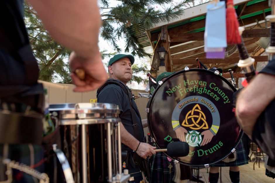 The New Haven County Firefighter's Pipe and Drum band had a small parade procession and performance for the St. Baldrick's fundraiser at Dawg House Bar & Grill in Meriden on Saturday. Monica Jorge, special to the Record-Journal