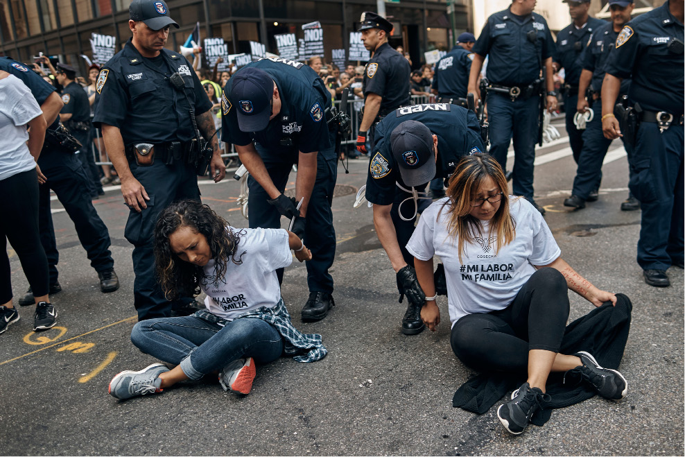 Above: Attorney General Jeff Sessions makes a statement at the Justice Department in Washington, Tuesday, on President Barack Obama's Deferred Action for Childhood Arrivals, or DACA program. Below: Police arrest activists as they block Fifth Avenue.| Associated Press