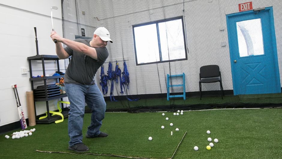 Wallingford Country Club Assistant Pro, Jay Mezzi, takes a few swings after a physical therapy session at Fyzical Therapy and Balance Center at 20 Chapel St. in Wallingford, Thursday, Jan. 18, 2018. Dave Zajac, Record-Journal