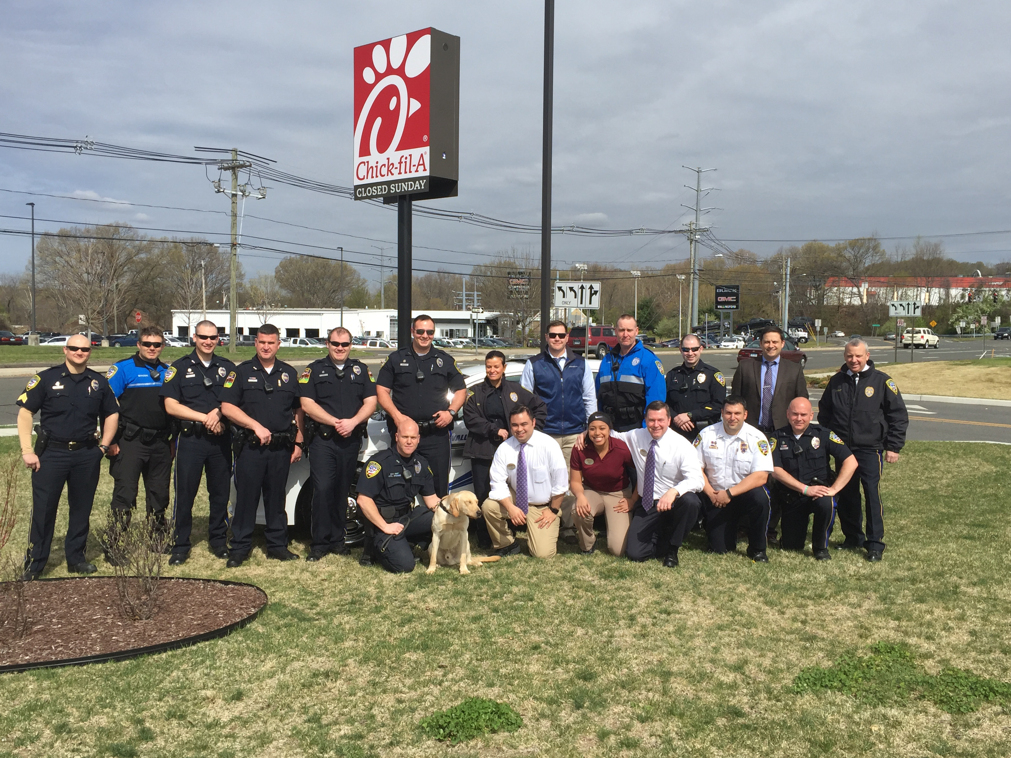 Members of the Wallingford Police Department host Coffee with a Cop Friday morning at Chick-fil-A restaurant on Route 5. The event is the first of several the department plansin the hopes of  building relationships and improving communication.