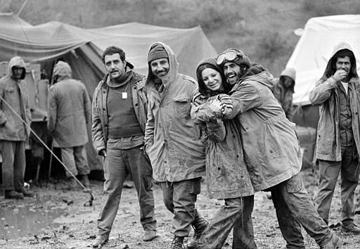 Israeli soldiers at the Syrian cease-fire line in the Golan Heights are seen, Oct . 31, 1973, after sudden cold, rain and fog hit them. Female soldier is radio operator Zehava Mizrachi. Other soldiers are unidentified. (AP Photo)