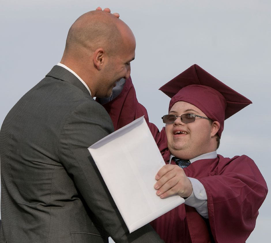 Graduate William Marotti rubs the head of Assistant Principal Justin Marciano after receiving his diploma during graduation ceremonies at Sheehan High School, Friday, June 22, 2018. Dave Zajac, Record-Journal