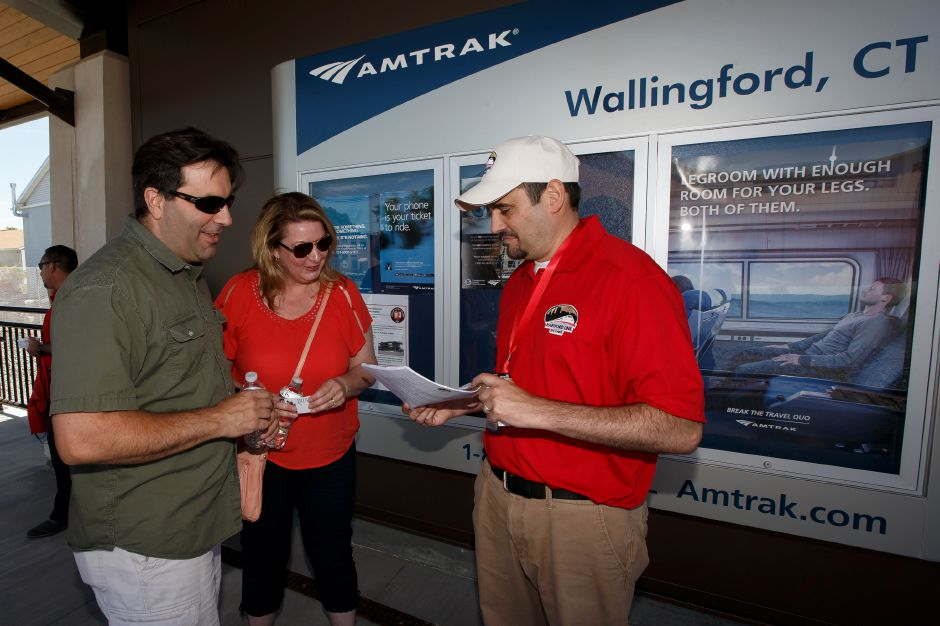 CT Rail Anthony Arcari helps passengers Mike and Diane Pascale of Wallingford Saturday during the opening weekend of the CT Rail Hartford Line in Wallingford June 16, 2018 | Justin Weekes / Special to the Record-Journal