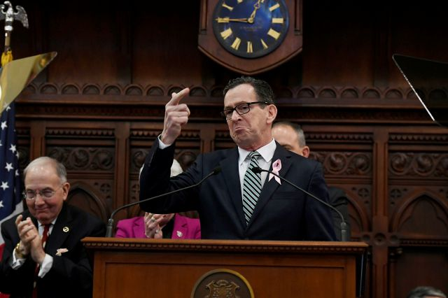 Connecticut Gov. Dannel P. Malloy, seen gesturing to his wife Cathy during opening session at the state Capitol, Wednesday, Feb. 7, 2018, in Hartford, Conn. (AP Photo/Jessica Hill)