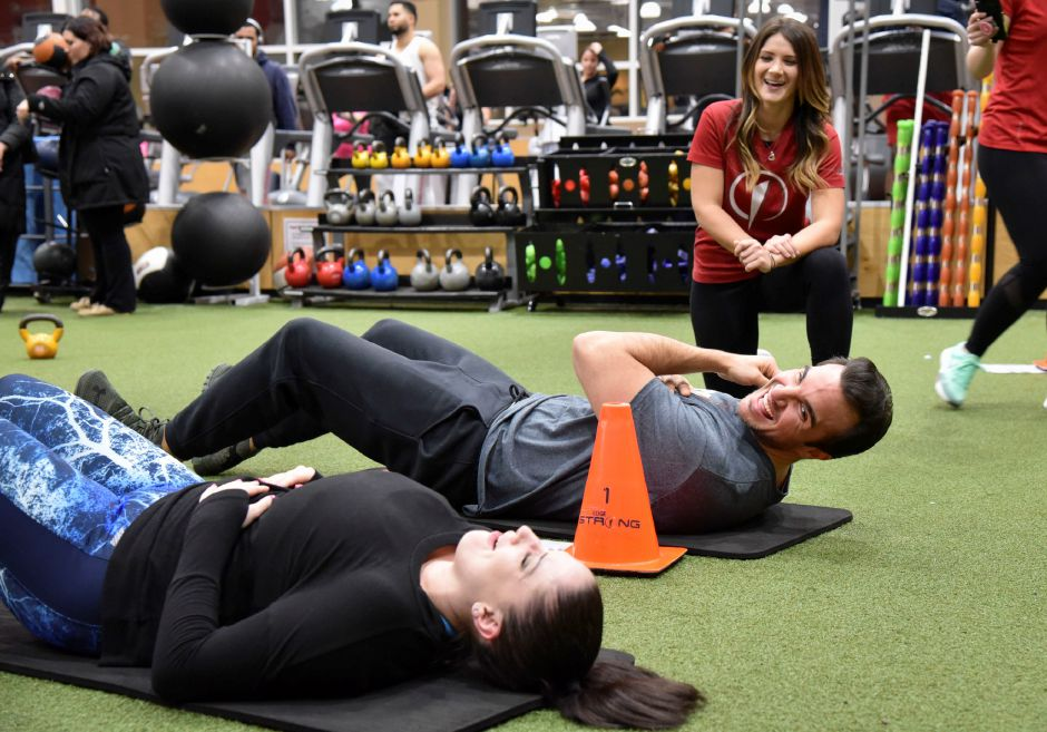 "Former ""The Bachelorette"" contestant and Meriden resident Matt Munson works out with fellow city resident Noel Tufano, who won The Edge sweepstakes to work out with Munson for Valentine"