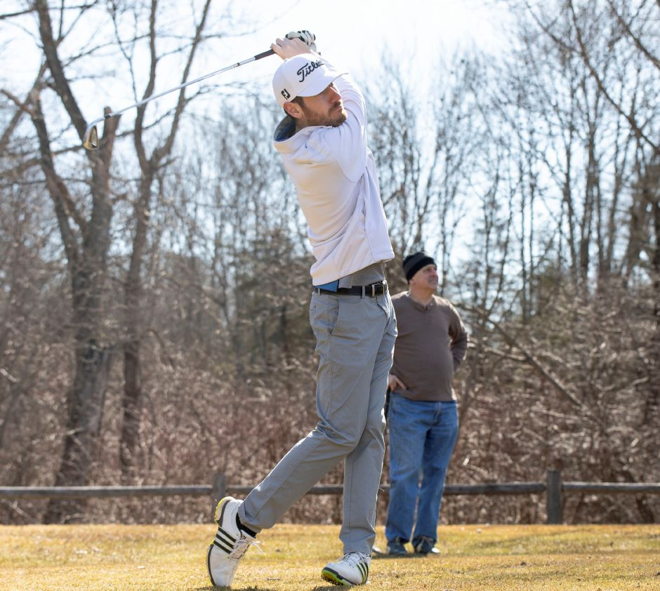 Cameron DaSilva, of Rocky Hill, tees off at Timberlin Golf Course in Berlin on opening day Sunday, March 24, 2019. After moving the first day of the season to the weekend the course sold out at 120 golfers. | Devin Leith-Yessian/Berlin Citizen