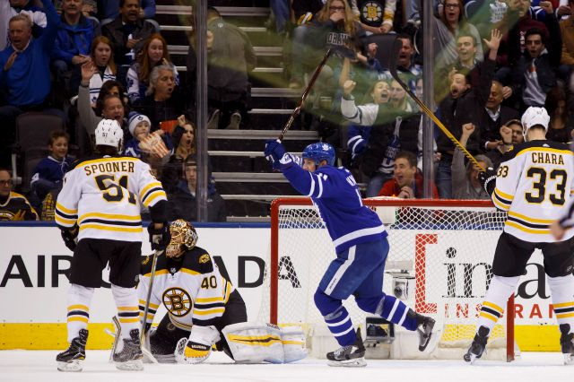 Toronto Maple Leafs center Zach Hyman (11) celebrates a goal against Boston Bruins goaltender Tuukka Rask (40) during the first period of an NHL hockey game Saturday, Feb. 24, 2018, in Toronto. (Cole Burston/The Canadian Press via AP)